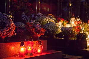 Candles, Wreaths and Flowers on Graves on All Souls' Day